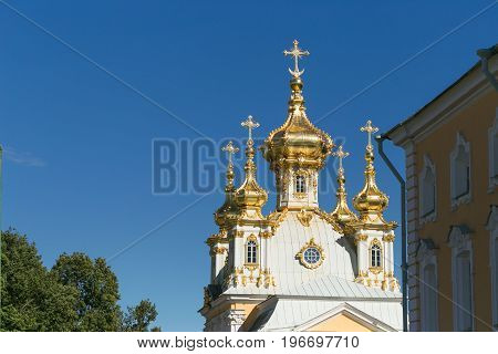 St. Petersburg, Russia - June 28, 2017: A Church With Golden Domes In Peterhof In St. Petersburg. Pe