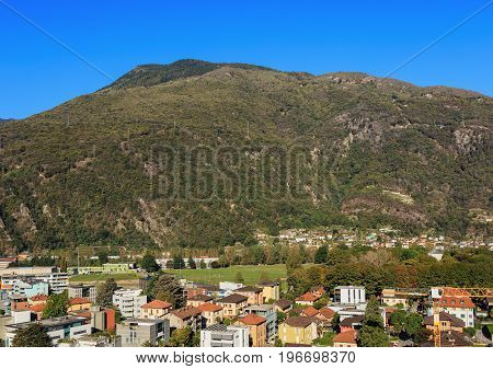 Buildings of the city of Bellinzona in the Swiss canton of Ticino, mountains in the background. The picture was taken at the middle of autumn.