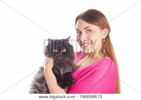 Pretty young woman in pink blouse holding black cat on white background