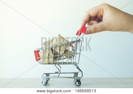 concept of buy shopping hand of woman pushing Red shopping cart full of gifts box.