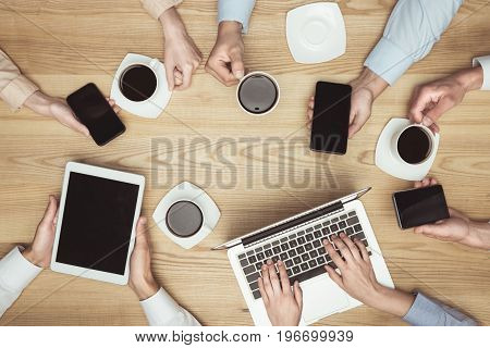 Top View Of Businesspeople On Brainstorming With Documents And Laptop, Smartphones, Digital Tablet A
