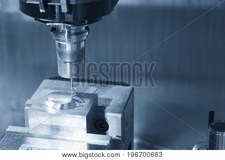 The CNC milling machine cutting the sample part with the small end-mill .Hi-precision CNC machining concept.