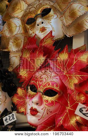Gold and red venetian masks, Venice, Itay