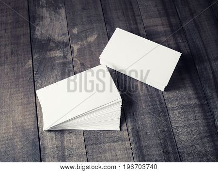 Blank business cards on vintage wood background. Mockup for ID. Responsive design template.