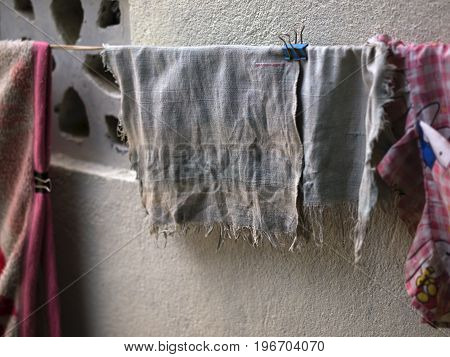 COLOR PHOTO OF OLD AND FADED HANDKERCHIEF DRYING OUTSIDE