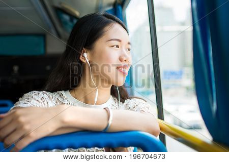 Girl Listening To Music On A Public Bus