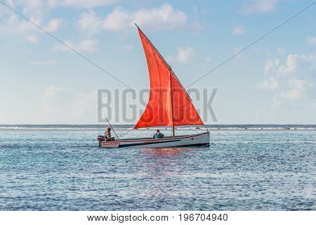 Blue Bay Mauritius - December 28 2015: The romantic boat with scarlet sail in Indian Ocean - Beautiful sea scene in Blue Bay Mauritius.