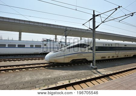 TONGXIANG CHINA - MARCH 25 2016: High Speed train on Tongxiang Railway Station on March 25 2016 in Tongxiang China. Tongxiang City is a county-level city in northern Zhejiang Province China.