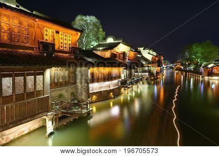 WUZHEN CHINA - MARCH 24: Night scene of Wuzhen on March 24 2016 in Wuzhen China. Wuzhen is a historic scenic town located in northern Zhejiang Province China