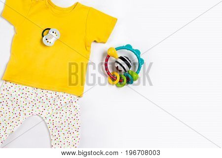 Baby clothes and accessories on white background. Top view. Copy space. Still life. Flat lay
