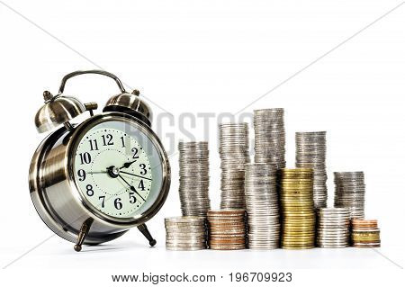 Stacks of coins and clock over white background Conception of business money and business growth.
