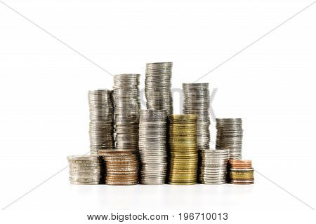 Stacks of coins over white background Concepts of business money saving and business growth.