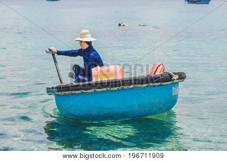 Nha Trang VIETNAM - MAY 19 2017: Fisherman in a Vietnamese boat like basket.