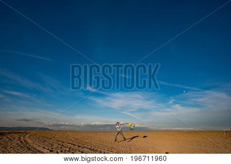 Woman with balloons under blue sky