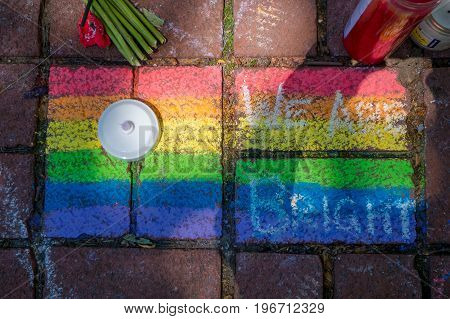 ORLANDO, USA - MAY 05, 2017: Gay flag drawed in the floor, place where Omar Mateen, killed 49 people and wounded 53 others in a terrorist attack hate crime in a gay nightclub in Orlando, Florida, United States.