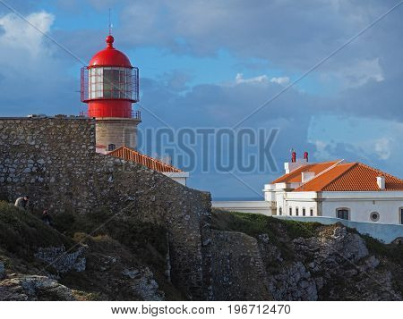 Red Lighthouse On Cabo De Sao Vicente With Stone Wall