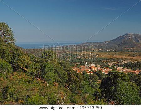 View On Village, Mountain And Sea With Green Trees