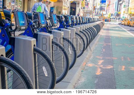 NEW YORK, USA - NOVEMBER 22, 2016: Close up of bike rental on Times Square parked in a row in the street in New York city USA.