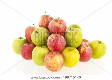 Big heap of red and green apples isolated over white background