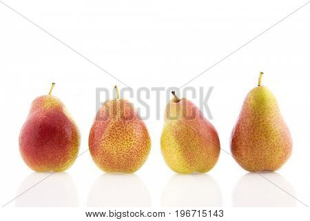 Row red and yellow pears isolated over white background