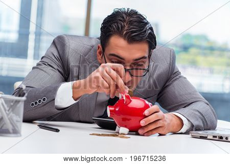 Bankrupt broke businessman with piggy bank