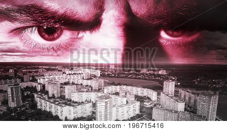 Evil eyes against the background of the city the concept of rage anger