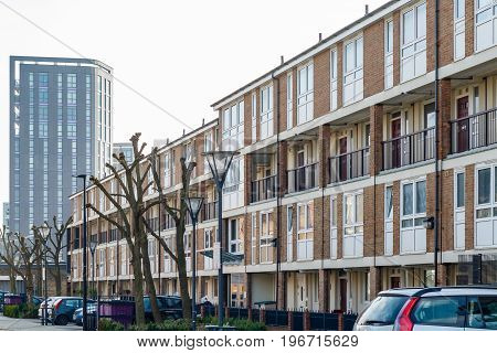 English Terraced Houses In Contrast To Modern Luxury Flats In The Background