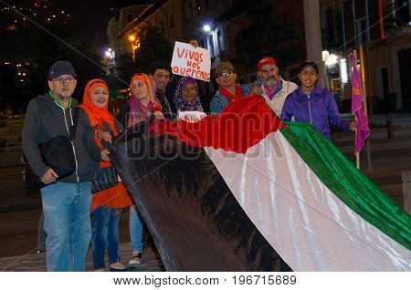 QUITO, ECUADOR- MAY 06, 2017: Unidentified group of people holding a flag during a protest against the femicide in Quito Ecuador.