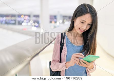 Woman use of mobile phone in airport