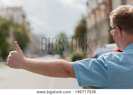 Smiling Middle-aged Man Catching Taxi In The City