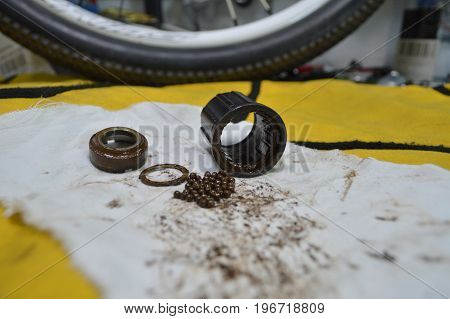 Worn-out Bicycle Bushing With Spokes