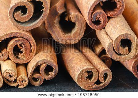 Close Up Bunch Cinnamon Sticks On Dark Wooden Table