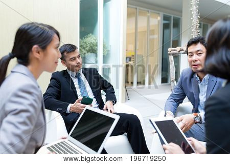 Group of business people discuss together