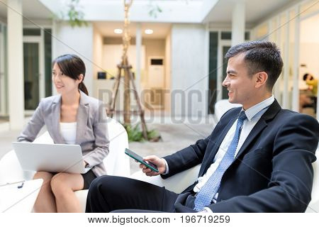 Businessman having discussion with his assistant