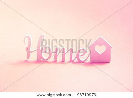 Word Home and small house with heart. 3d illustration.