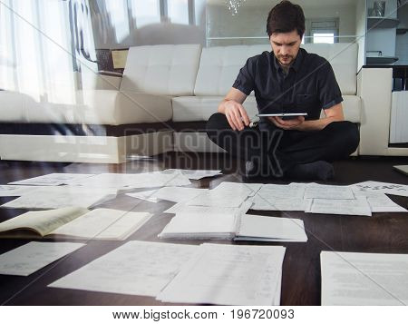 Young male entrepreneur makes brainstorming sitting on the floor in the apartment. the double exposure effect
