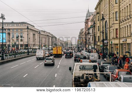 Saint Petersburg, RUSSIA - May 31, 2017: Nevsky Prospekt view from bus, street, city traffic, cars, rainy day, Saint Petersburg, Russia