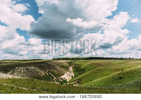 Fantastic nature countryside landscape. Cloudy sky and green hills