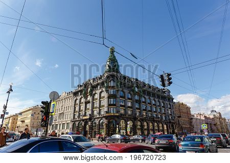 Saint Petersburg, RUSSIA - June 1, 2017: Singer House or House of Books with dome and bronze sculptures on the corner of Nevsky Prospekt and Griboedov Canal, Saint Petersburg, Russia