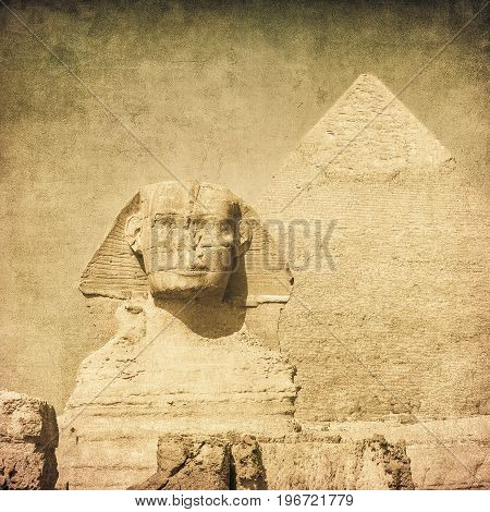 Highly detailed grunge image of sphynx and pyramid