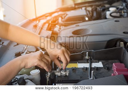 Hand of woman checking car and battery broke