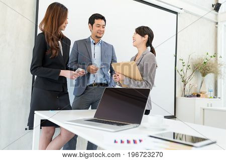 Business people talking to each other in office