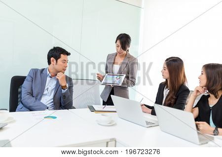 Business woman presenting to colleague