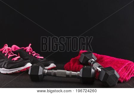 Female sport clothing and equipment copy space. Sneakers, dumbbells and towel. Active lifestyle, body care concept