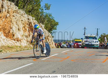 Col du Serre de TourreFrance - July 152016: The British cyclist Adam Yates of Orica-BikeExchange Team in White Jersey is riding during an individual time trial stage in Ardeche Gorges on Col du Serre de Tourre during Tour de France 2016.