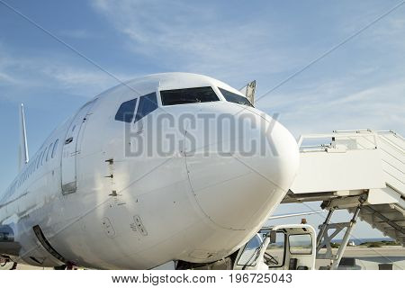 The white airplane parked at the airport
