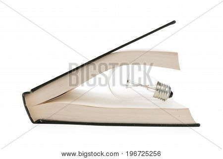 book and light bulb business education concept.