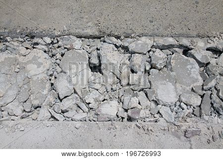 Concrete road is broken for repair at construction site.