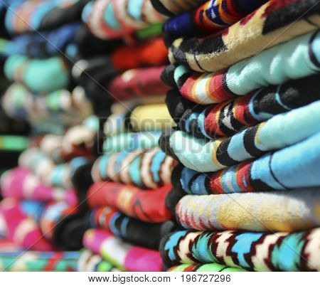 An Assortment of Colorful Stacked New Mexican Indian Blankets Arranged in a Row