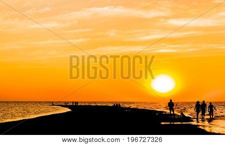 Picturesque orange sunset over the sea on the summer evening